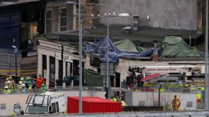Emergency services at the Clutha Bar in Glasgow where a police helicopter crashed last night.