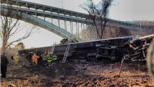 Train carriage under bridge