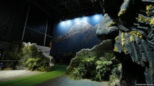A giant pop-up book showing a mountain scene