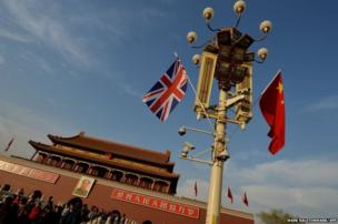 A British and a Chinese flag near the portrait of Mao Zedong