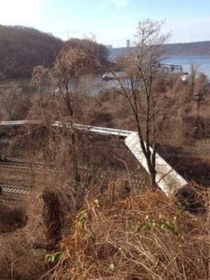 Train carriages overturned in Spuyten Duyvil