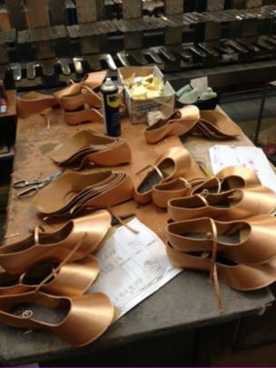 Shoes being made at factory
