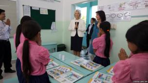Christine Lagarde, Managing Director of the International Monetary Fund, greets school girls at Toutes a l'Ecole school in Kandal province, Cambodia