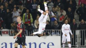 Monaco forward Emmanuel Riviere (C) celebrates with a flip after scoring a goal during the French L1 football match between Nice (OGC Nice) and Monaco (ASM) on December 3, 2013, at the Allianz Riviera stadium in Nice, France.