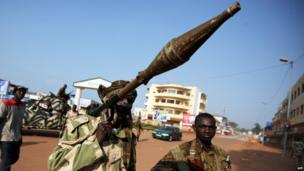 A soldier on patrol carries a rocket propelled grenade in a street of Bangui on December 5, 2013
