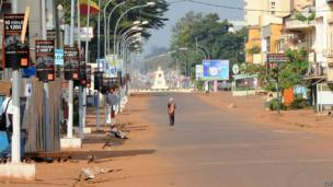 A man walks down the middle of a street of Bangui on 5 December, 2013