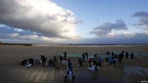 People filling sandbags in Gorleston-on-Sea