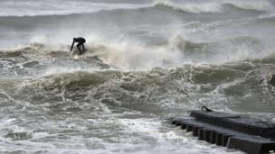 Surfer in the storm, Hanstholm, northern Jutland, Denmark (5 Dec)