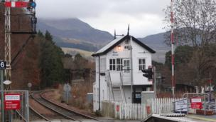 Blair Atholl station and signal box with the viaduct over the River Tilt and Creag Eallaich in the background. Taken by John Walker (Barnet), back in Scotland on holiday.