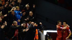 Liverpool's Uruguayan striker Luis Suarez (R) celebrates scoring his third goal