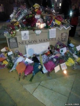 Candles being lit in London. Photo: Allison Hinds