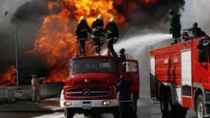 Firemen on fire engines in Abuja, Nigeria - Thursday 5 December 2013