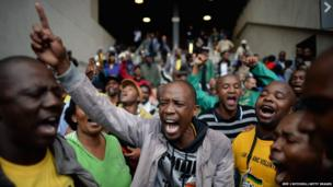 Members of the public arrive for the Nelson Mandela memorial