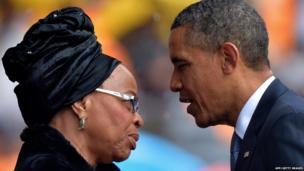 President Barack Obama greets Nelson Mandela's wife, Graca Machel.