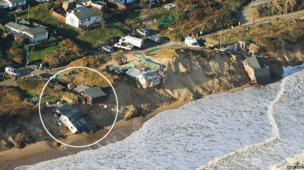 Aerial view of the cliff at Hemsby after the tidal flood resulting in homes falling down the cliff