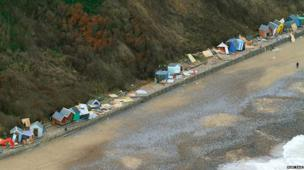 Beach huts along the Norfolk coast at Cromer were destroyed in the tidal surge