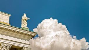 A statue on top of the Helsinki Cathedral at noon
