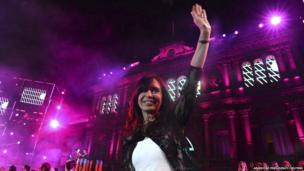 Argentina's President Cristina Fernandez de Kirchner waves during celebrations of the 30th anniversary of Argentina's return to democracy, at the Casa Rosada Presidential Palace in Buenos Aires December 10, 2013