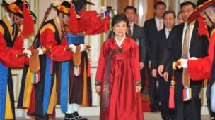 South Korea's new President Park Geun-hye arrives at the official dinner at the presidential Blue House in Seoul on 25 February 2013