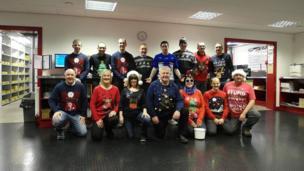 People wearing Christmas jumpers