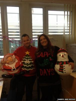Darryl and Nicole and their Christmas jumpers