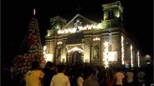 People attend the first of nine dawn masses in suburban Manila on December 16, 2013 to signal the official start of the Christmas season.
