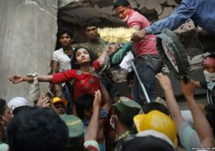 A survivor is lifted out of the rubble by rescuers at the site of a garment factory building that collapsed in Savar, Bangladesh, near Dhaka.