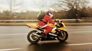 Father Christmas riding a motorbike