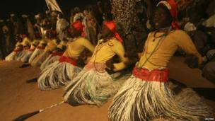 Performers dressed in traditional costumes dance in Khartoum,. Sudan, on 14 December 2013