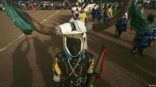 A performer dressed in traditional costumes participates in a ceremony in Khartoum, Sudan on 14 December 2013