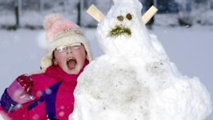 Saskia and a snowman