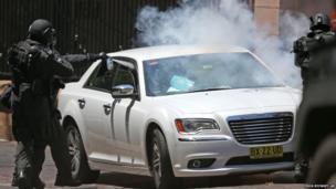 Police rush a car in Sydney