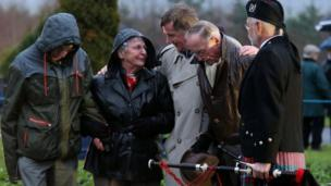 Marie and Frank Klein are comforted after the Lockerbie service