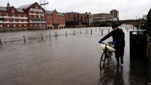 Rising water levels from the River Ouse bring floodwater into riverside roads in York City centre as heavy rain and gales sweep across many parts of the UK.