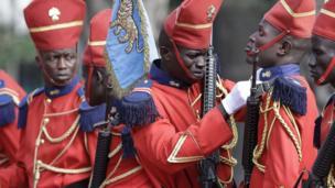 A member of a Senegalese guard of honour adjusts his colleague's collar, Dakar, Senegal - Thursday 27 June 2013
