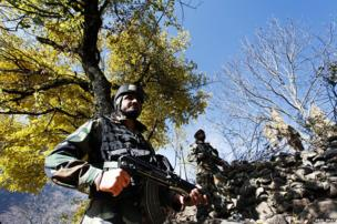 Indian Army soldiers stand guard near the Line of Control in Uri, some 125 km north of Srinagar.