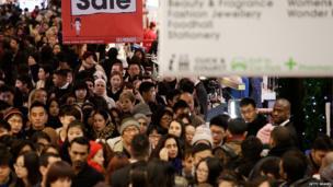 Shoppers inside Selfridges in London.