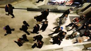 Shoppers enter Harrods in London.