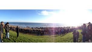 People watching the dip at Seaburn