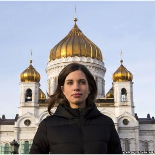 Nadezhda Tolokonnikova of Russian punk group Pussy Riot walks in front of the cathedral of Christ the Saviour in Moscow on December 27, 2013