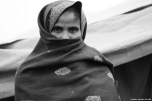 Khurshida, mother of Anas Younis, 7, who died suffering from fever at Loi village camp.