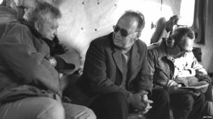 Ariel Sharon, left, with Israeli PM Yitzhak Rabin (centre) in a military helicopter on 11 December 1975