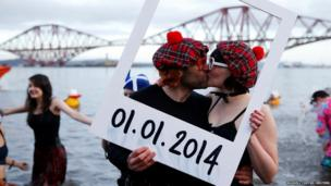 Swimmers in fancy dress at South Queensferry, Scotland