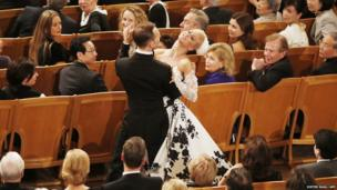 A couple dance in the Golden Hall in Vienna