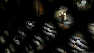 Pope Francis conducts a mass at the Church of the Most Holy Name of Jesus in Rome