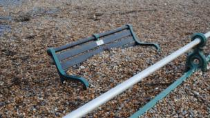Bench covered in pebbles. Photo: Chris Limb