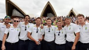 Australia's cricket team members (L-R) Nathan Lyon, Chris Rogers, Mitchell Johnson, Ryan Harris, Michael Clarke, David Warner, Shane Watson, and James Faulkner pose for pictures in front of Sydney's iconic Opera House during a ceremony to celebrates their Ashes Test series victory against England with public on 7 January 2014