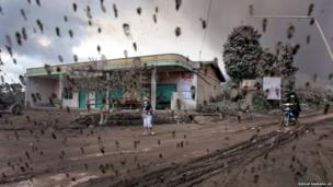 Villagers are seen through the windscreen of a car during an ash fall from the eruption of Mount Sinabung
