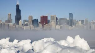 Chicago skyline can be seen through the arctic sea smoke rising off Lake Michigan