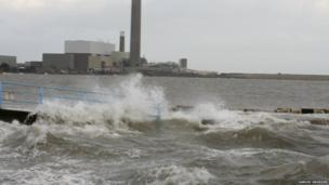 Waves also crashed against the shore of Belfast Lough at Carrickfergus, County Antrim, as Samuel Snodden's picture shows.